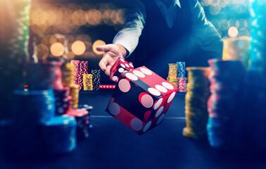 Fototapeta Man gambling at the craps table at the casino