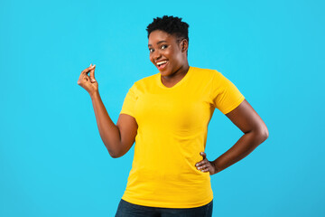 African Oversized Woman Clicking Fingers Standing Posing On Blue Background