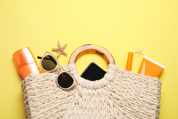 Obraz Flat lay composition with sun protection products and beach accessories on yellow background - fototapety do salonu