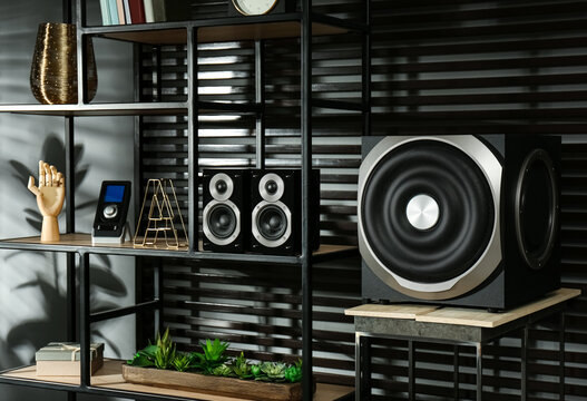Modern audio speaker system on shelving indoors