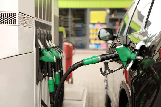 Refueling modern car at gas filling station, closeup