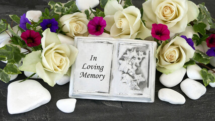 Book with the inscription n loving memory
