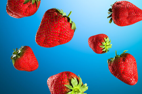 Juicy ripe strawberries on blue background. Natural organic food. Healthy lifestyle. High quality 3d illustration