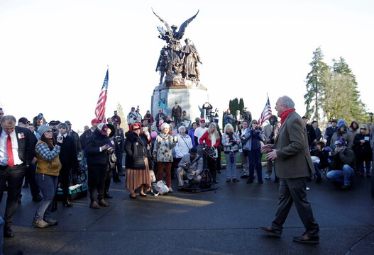 Republican U.S. representative Jim Walsh speaks to supporters of U.S. President Donald Trump at the Winged Victory Monument, the day before a legislative session begins in Olympia, Washington