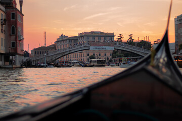 Beautiful sunset in the Gran Canal of Venezia with a gondola