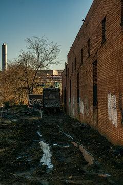 behind old warehouse brick building