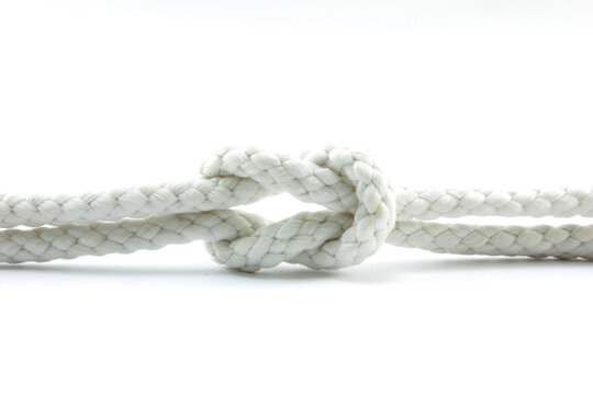 Close-up Of Tied Knot On Rope Against White Background