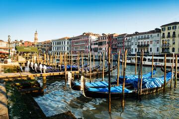 Gondolas Moored In Canal Against Buildings