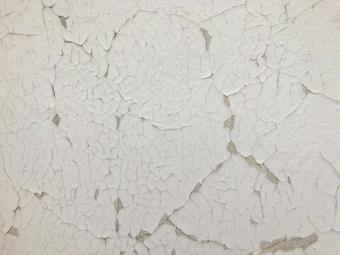 Old cement wall with peeling paint