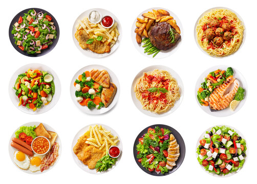 various plates of food isolated on a white background, top view
