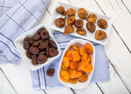 Variety of dried fruit in bowls on table, top view
