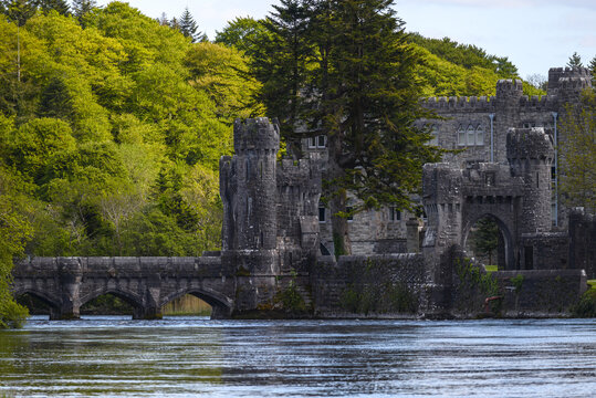 Ashford castle with stone bridge, river and forest, located near Cong on the Mayo-Galway border in Ireland