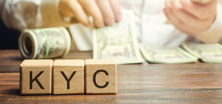 Wooden blocks with the word KYC - Know Your Customer / Client. Verify the identity, suitability and risks involved with maintaining a business relationship. Anti-bribery compliant