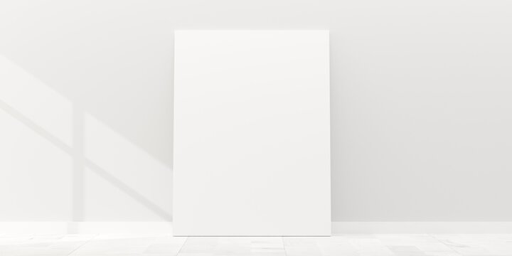 Empty picture frame canvas mock-up leaning against white wall in room with white wooden floor and window shadow with copy space - portfolio, gallery or artwork template mock up