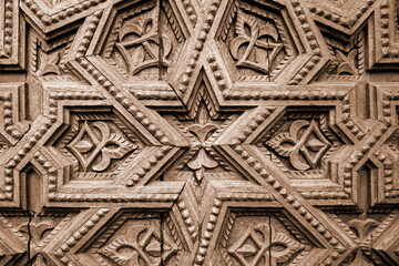 Wood Carving Ornament Pattern Background. Decorative Wooden Star Decor Craft Panel. Geometric Carved Gate Door Close-up.