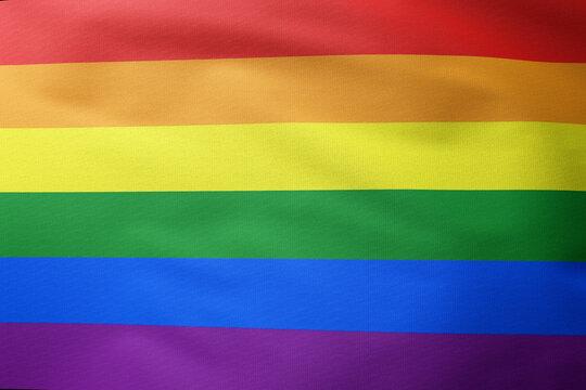 rainbow flag waving, the gay pride flag or LGBT pride flag symbol of lesbian, gay, bisexual, transgender