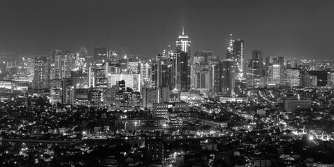 Fototapeta Illuminated Cityscape Against Sky At Night