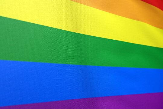 the gay pride flag rainbow flag waving or LGBT pride flag symbol of lesbian, gay, bisexual, transgender