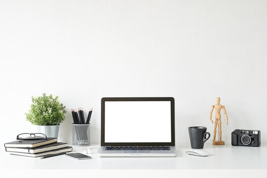 Laptop By Objects On Table