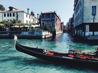 View Of Gondola In Canal Against Buildings