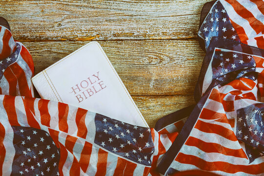 Directly Above Shot Of Holy Book Covered In American Flag On Table