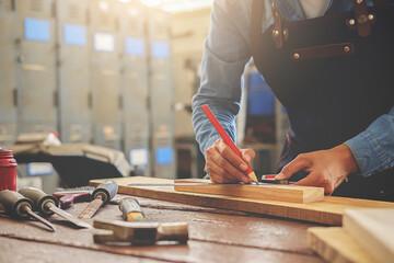 Fototapeta Midsection Of Carpenter Working In Workshop obraz