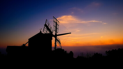 Obraz Silhouette Of Traditional Windmill Against Sky During Sunset - fototapety do salonu