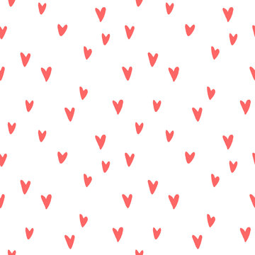 Seamless abstract pattern of small red hearts. Hand drawn doodle background, texture for textile, wrapping paper, Valentines day