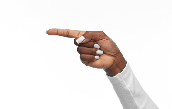 gesture and people concept - hand of african american woman pointing finger to left on white background