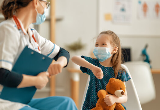 Doctor and child wearing facemasks