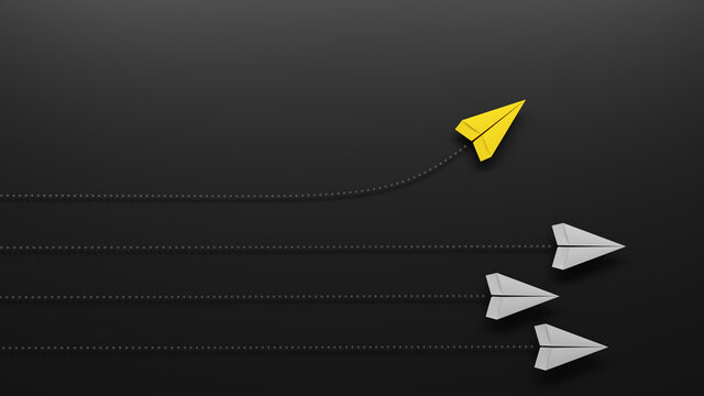 Group of paper planes flying in one direction and one turning in another direction. Business concept for new ideas, innovative solution and creativity.