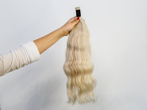 Bundle of blonde natural human hair extensions