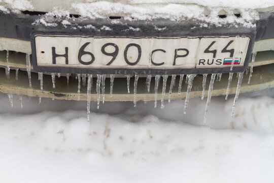 Kostroma, Russia - 05 01 2021: The license plate of the Russian car is frozen, covered with icicles and snow in winter.