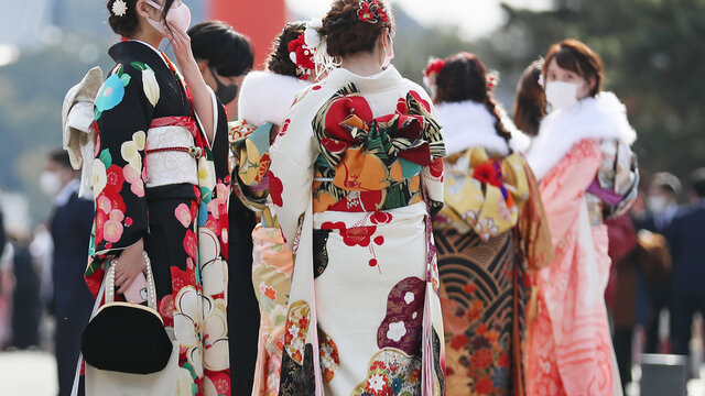 Japanese young girls wearing mask in Kimono (furisode)