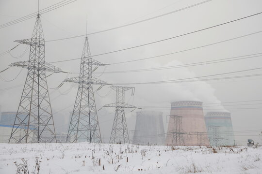 Chimneys of a heating power plant and electricity power lines are seen on a cold winter day in Moscow