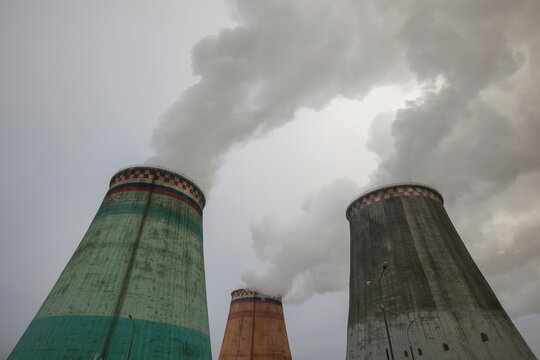 Steam rises from chimneys of a heating power plant on a cold winter day in Moscow