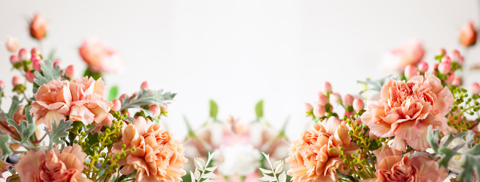 Autumn composition made of beautiful flowers on light backdrop. Floristic decoration. Natural floral background.