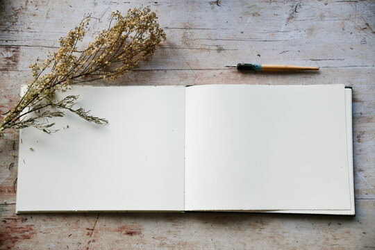 Blank journal open for creative writing or journaling art activities
