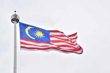 Obraz Low Angle View Of Malaysian Flag Against Clear Sky - fototapety do salonu