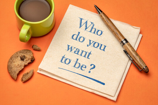 Who do you want to be? Inspirational question on napkin with a cup of coffee. Career and personal development concept.
