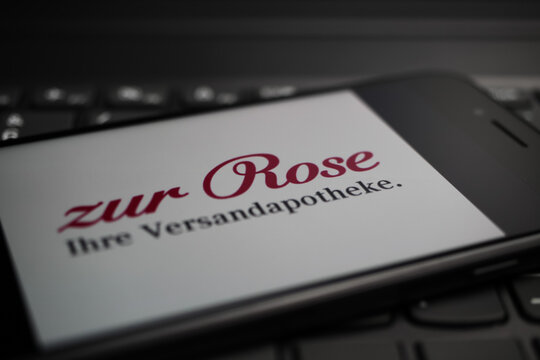 Viersen, Germany - May 9. 2020: Close up of mobile phone screen on computer keyboard with logo lettering of german online mail-order pharmacy zur Rose