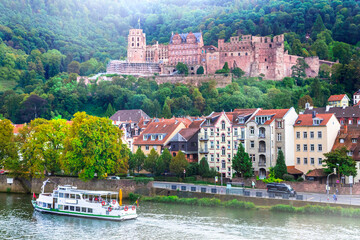 Landmarks and beautiful old towns of Germany - medieval Heidelberg, view with castle and river boat