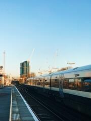 Fototapeta Train At Railroad Station Against Clear Blue Sky obraz