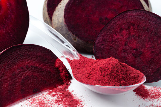 Superfood beetroot powder on a white background. Healthy eating concept dry beet powder.