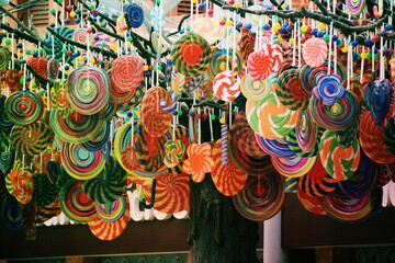 Colorful Decorations Hanging For Sale At Store - fototapety na wymiar