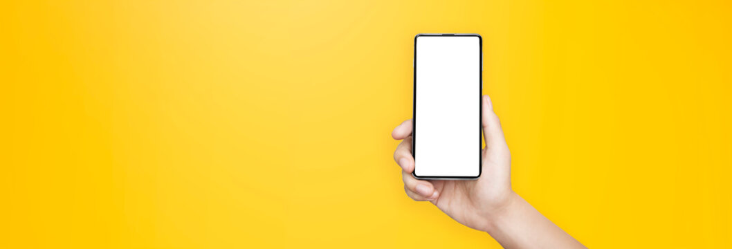 concept - cell phone in a man's hand on yellow background