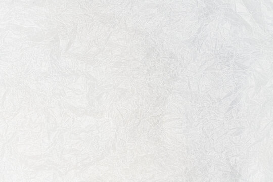 White crumpled wax paper texture abstract background