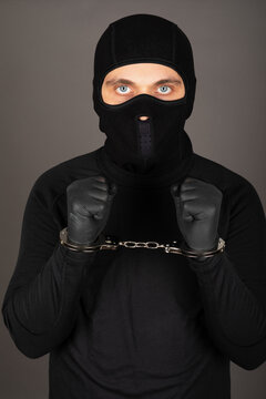 Man with black mask with handcuffs