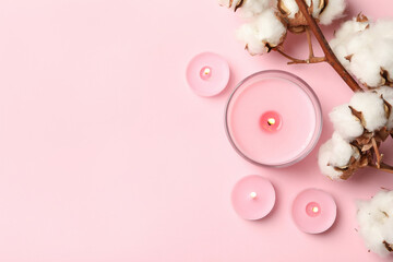 Fototapeta Scented candles and cotton on pink background