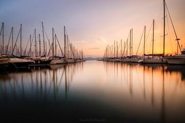 Fototapeta Sailboats Moored In Marina At Sunset obraz
